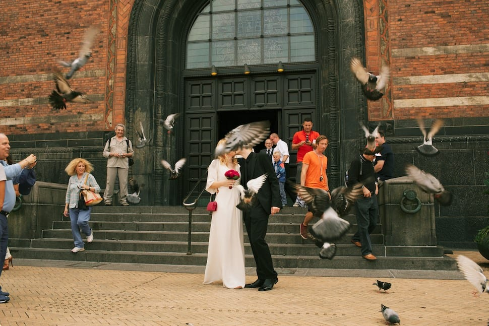 Bride and groom going out of the Copenhagen´s Council ceremony