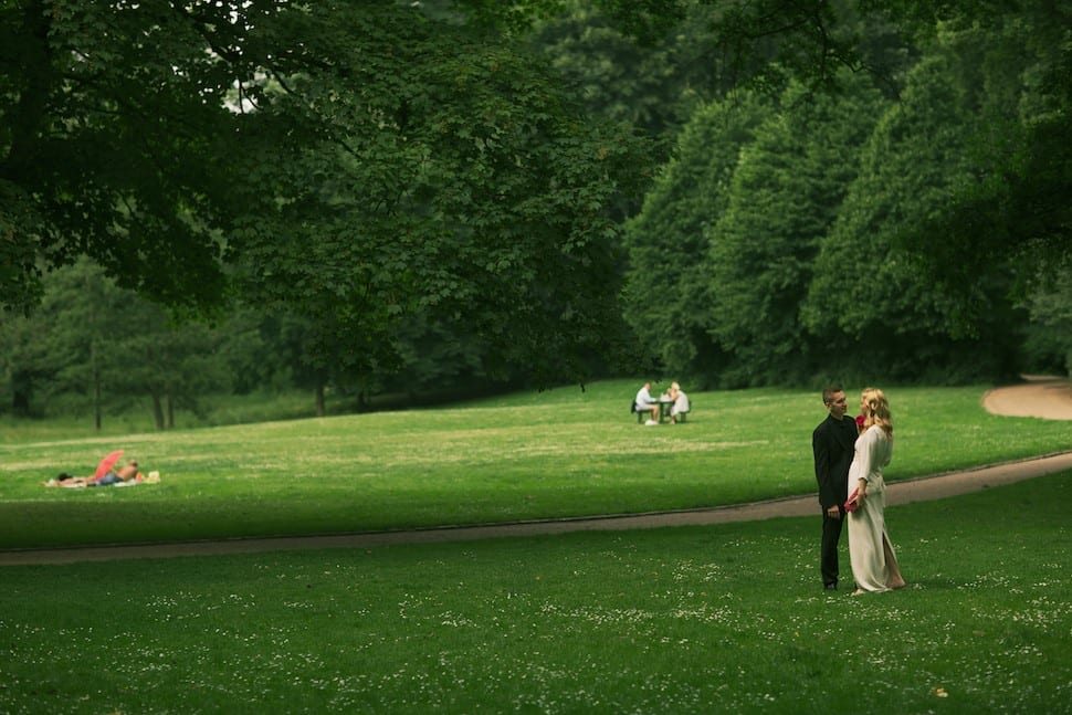 Bride and groom posing in the park