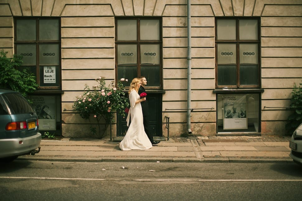 Bride and groom walking in the street in Copenhagen